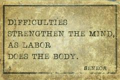 Mind strength Seneca. Difficulties strengthen the mind - ancient Roman philosopher Seneca quote printed on grunge vintage cardboard stock photos
