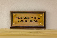 Mind your head plaque Stock Photos