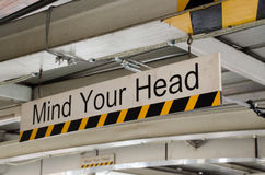 Mind your head. Sign of mind your head Stock Images