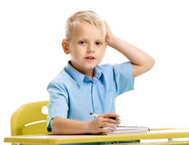 Minded cute boy at the lesson Stock Photos