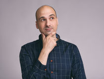 Minded man in shirt touching his chin Royalty Free Stock Image
