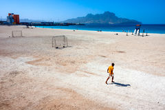 Mindelo Beach and a lifesaver  walking Royalty Free Stock Photography