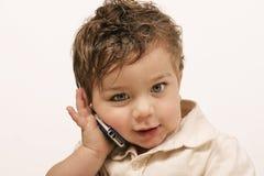 Mindere met cellphone royalty-vrije stock foto's