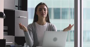Mindful calm young woman meditate at work with eyes closed