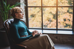 Mindful female psychologist tensely thinking Royalty Free Stock Images