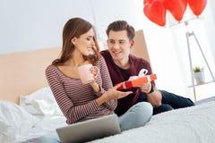 Mindful gentleman giving his girlfriend gift Royalty Free Stock Photo