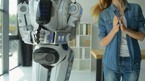 Mindful girl teaching robot new dance stock footage