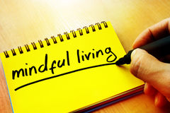 Mindful living. Mindful living written in a note Royalty Free Stock Photography
