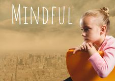 Mindful text and Girl sitting in chair over city Stock Photo