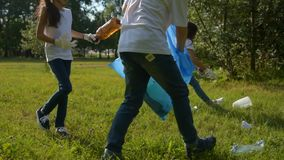 Mindful young volunteers cleaning local park area