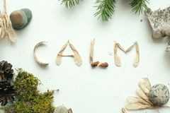 Mindfulness calmness unplug concept, word calm from forest natural material.  Stock Photos