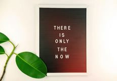 Mindfulness - do it NOW. There is only the NOW written on Letter board on white background royalty free stock photo