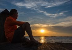 MINDFULNESS. And meditation along the dockside sunset stock photography