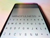 MINDFULNESS indicado no telefone celular foto de stock