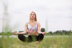 Mindfulness meditation in nature. With legs crossed and eyes closed Stock Photo