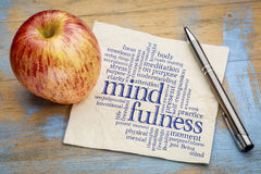 Mindfulness word cloud on napkin. Mindfulness word cloud on a napkin with a fresh apple royalty free stock photo