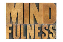 Mindfulness word in wood type. Mindfulness word abstract  - awareness concept - isolated text in letterpress wood type Royalty Free Stock Photo
