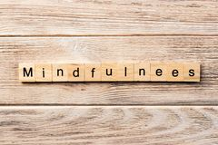 Mindfulness word written on wood block. mindfulness text on table, concept stock photos