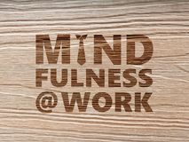 Mindfulness At Work concept using wood grain background. Mindfulness At Work conceptual design using wood grain as background stock photo