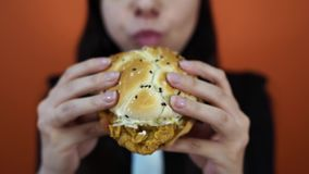 Mindless eating, fast food, unhealthy eating, overeating, self-control, hunger, nutrition concept. Young woman eating