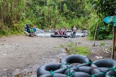 Group of tourists is preparing for tubing. stock photo