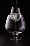 Mindre vinexponeringsglas i det större arkivbild