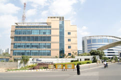 Mindspace Offices, Hyderabad. HYDERABAD, ANDHRA PRADESH, INDIA - JANUARY 5: workers passing the modern offices in the HiTec City campus in Hyderabad on January 5 Royalty Free Stock Image