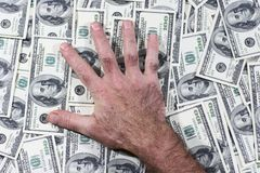 This is mine 1. Man's hand which lays on the dollars Stock Photography