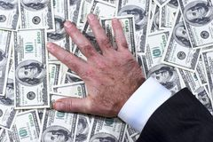 This is mine 2. Man's hand which lays on the dollars stock photo