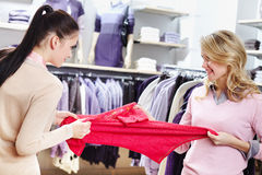 This is mine. Aggressive girls fighting for red tanktop in department store Royalty Free Stock Images