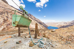 Mine cable trolley mountains carriage truck lake, Bolivia industry. Stock Photo