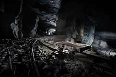 Mine cart. Abandoned mine with cart on the tracks stock image