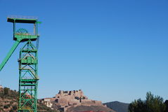 Mine and castle of Cardona. Disused tower mine and Castle of Cardona over a blue sky, Catalonia, Spain Stock Images