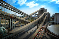 Mine with conveyor belts. Conveyor belts and mine with clouds and sky in background royalty free stock photo
