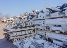 Mine equipment stockpiled at the mine yard Stock Photography