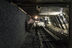 Mine excavator facing coal wall Royalty Free Stock Images