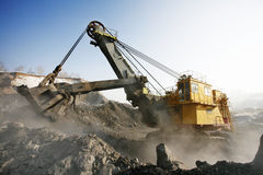 Mine excavator at work. Big mine excavator at the worksite. Winter Royalty Free Stock Images