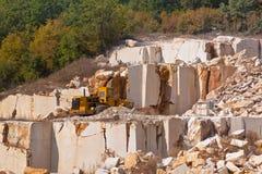 Mine limestone. Mine and bulldozer to move the rock mass Stock Photography
