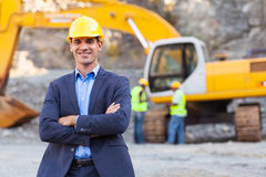 Mine manager. Cheerful manager with arms crossed royalty free stock photography