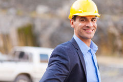 Mine manager. Smiling mine manager at mining site royalty free stock images