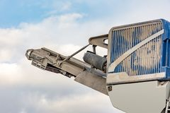 Mine in the open air. Detail of a stone crusher machine royalty free stock image