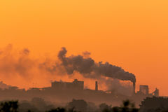 Mine polluting the atmosphere stock photography