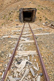 Mine rail and shaft. An abandoned mine shaft and rail royalty free stock images