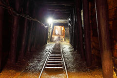 Mine with railroad track - underground mining royalty free stock photo