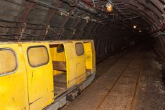 Mine railway in undergroud. Modern coal mine . Real underground post mine illuminated tunnel. Royalty Free Stock Image