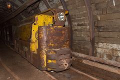 Mine railway in undergroud. Modern coal mine . Real underground post mine illuminated tunnel. Royalty Free Stock Photo