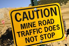 Mine Road Traffic. Yellow Caution Sign. Mine Road Traffic Does Not Stop. Gold Mine Signage Royalty Free Stock Photo