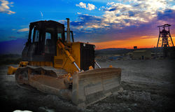 Mine shaft sunrise with earth mover machine Royalty Free Stock Photo