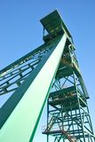 Mine tower. Perspective view of a mine tower over a blue sky Royalty Free Stock Photo