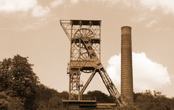 The mine tower for coal mining - sepia color royalty free stock photography